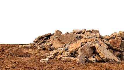 Isolated view of concrete debris piles on the ground.