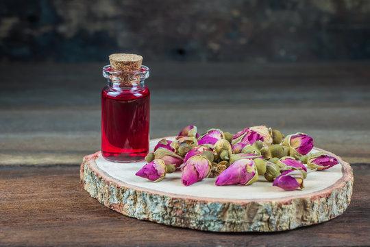 Rose oil in small glass bottle