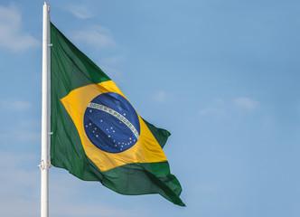 Foto op Canvas Brazilië Brazil flag waving at the wind against blue sky
