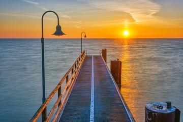 Pier at the german baltic sea coast at sunrise