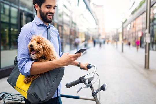 People, style, technology, leisure and lifestyle concept. Happy young man with smartphone on city street