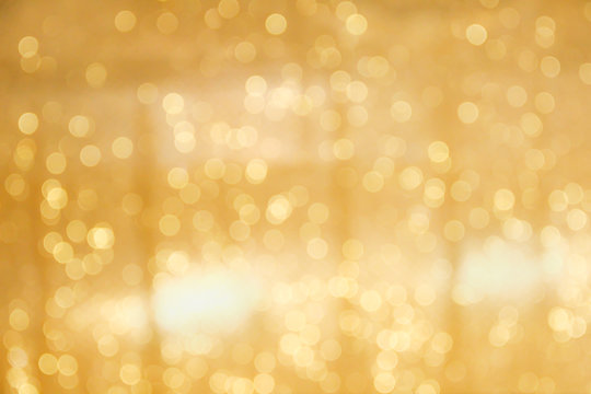 Gold bokeh sparkle glitter abstract patterns for Christmas and Happy new year background