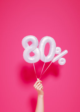 80 % sale banner white balloons and holding hand on pink. 3d rendering.