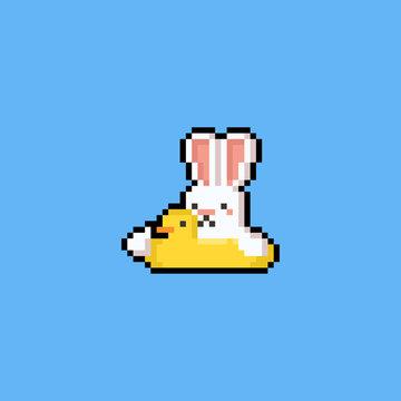 Pixel art cartoon rabbit on the duck swim ring.8bit.