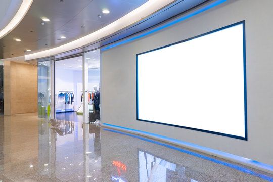 Interior shopping mall with blank billboards