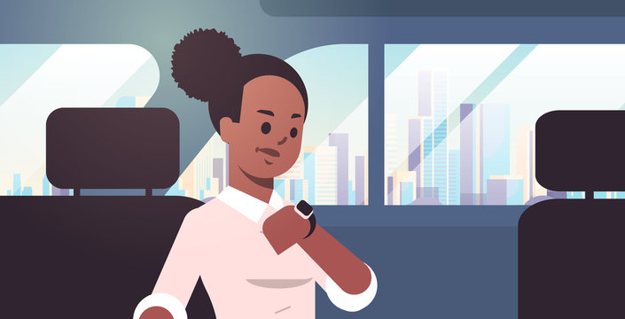 young businesswoman checking time african american woman car passenger sitting on back seat in taxi cab city transportation service concept flat portrait horizontal
