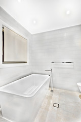 White ceramic bathing tub in luxury room.