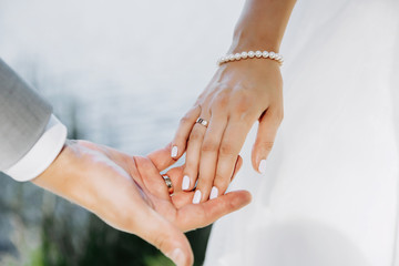 Married couple holding hands. Close up image.