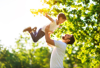 concept of father's day! happy family dad and child daughter    in nature.