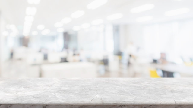 Empty white marble stone table top and blur glass window wall in office building space interior background - can used for display or montage your products.