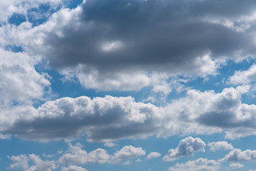 Canvas Prints Thick gray clouds in the blue sky on a sunny day. Natural background.
