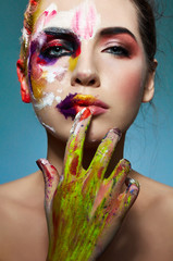 Beautiful model with colorful creative body art