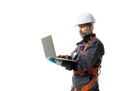 Senior engineer using laptop isolated white background