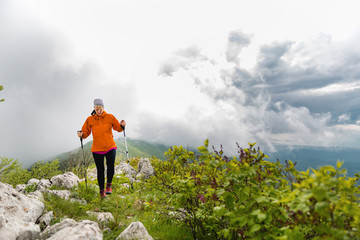Woman Hiking alone in the mountains