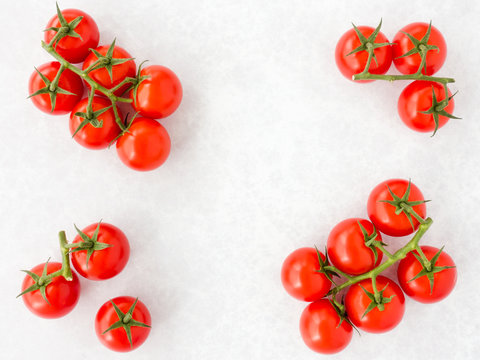Arrangement of Tomatoes on the Vine on Gray Background