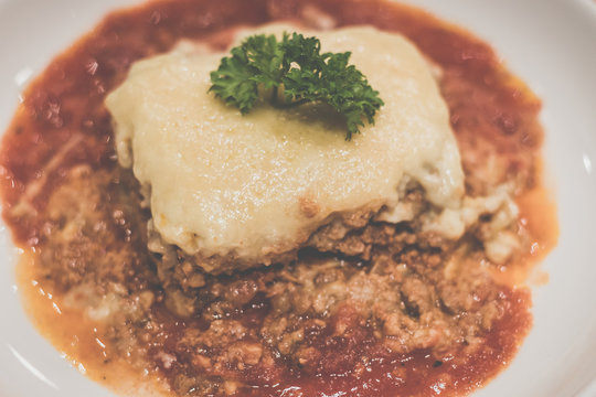 Chicken Lasagne Layers of thick pasta smothered with minced chicken, tomato sauce and cream