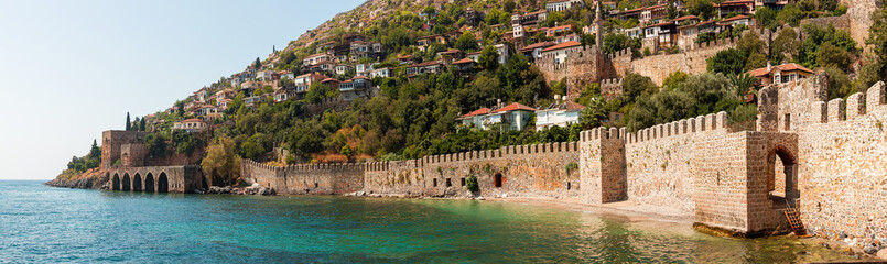 Panorama ancient Greco Roman city. Ruins of an ancient fortress, Alanya, Turkey. Ruined ancient military fort in Europe. Alanya is popular tourist destination in Turkey Fototapete