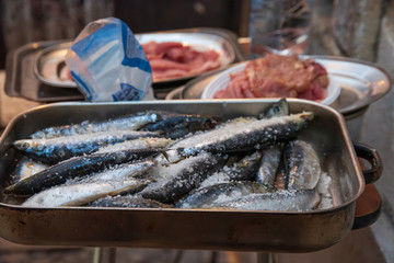 sardines and meat to grill