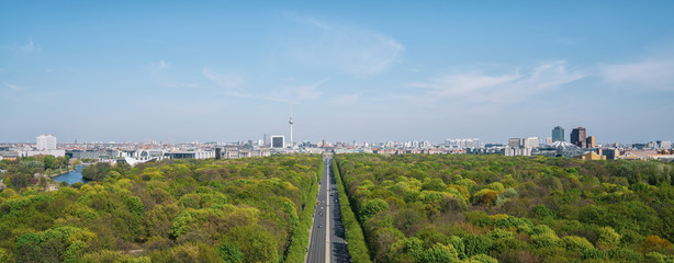Aerial view of Berlin skyline panorama with Grosser Tiergarten public park on a sunny day with blue sky and clouds in summer seen from Berlin Victory Column (Berliner Siegessaeule), Germany