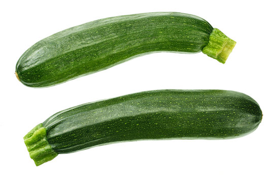 fresh green zucchini with slice isolated on white background. top view
