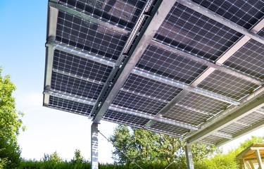Fototapeta New carport with semi transparent photovoltaik moduls obraz
