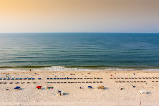 A beach in Gulf shores alabama from above at sunrise in early summer
