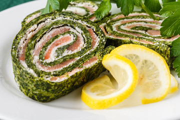 Roll salted salmon, cream cheese and spinach