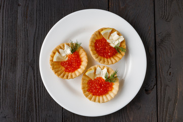 Tartlets with cheese and red caviar. Selective focus