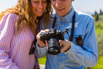 Couple looking at pictures on their digital camera