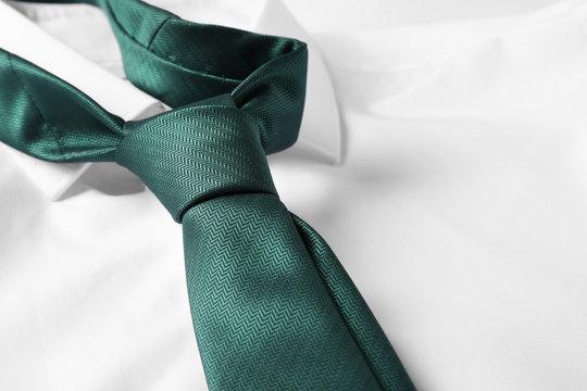 Color male necktie on white shirt, closeup
