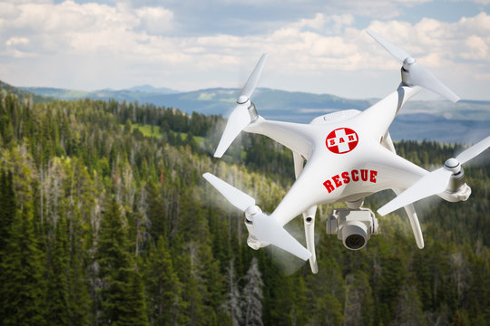 SAR - Search and Rescue Unmanned Aircraft System, (UAS) Drone Flying Above A Mountain Forest