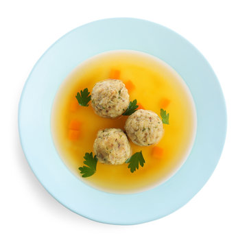 Dish of Jewish matzoh balls soup isolated on white, top view