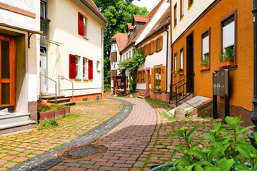Narrow street in the old town of Amorbach in Lower Franconia, Bavaria, Germany