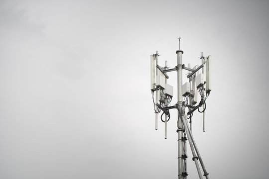 3G, 4G, 5G. Mobile phone base station Tower. Development of communication system in urban area with blue sky background
