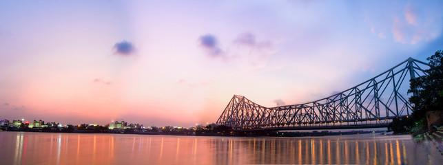 Poster de jardin Ponts Panorama of Howrah bridge on river Ganges in kolkata city , India