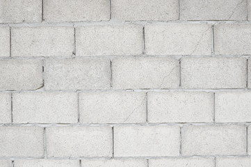 Old cement blocks wall texture and background.