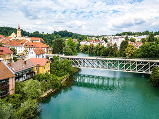 Aerial view of red roofs of Novo Mesto (previously Rudolfswerth, Newestat), Slovenia, Lower Carniola region, near Croatia. Historic Kandija iron bridge (Old Bridge), on the bend of the Krka River