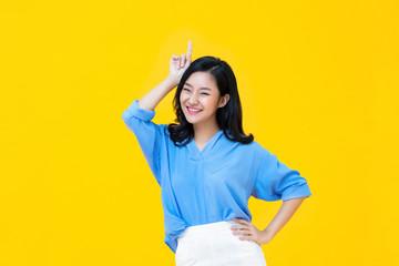 Smiling Asian woman standing in studio