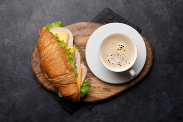 Coffee and croissant sandwich