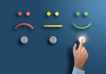customer service rating and survey concept with hand touching interface button with smiling face