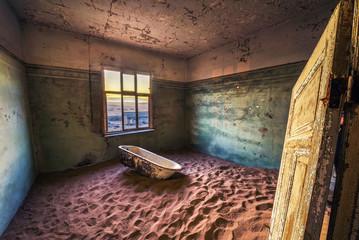 Ruins of the mining town Kolmanskop in the Namib desert near Luderitz in Namibia Wall mural