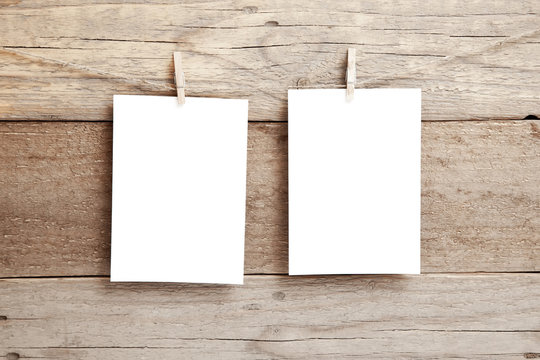 Stylish invitation layout - two empty cards on a wooden background