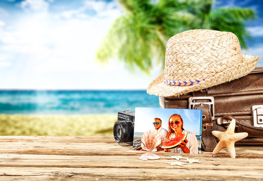 Summer beach with suitcase on desk and summer time