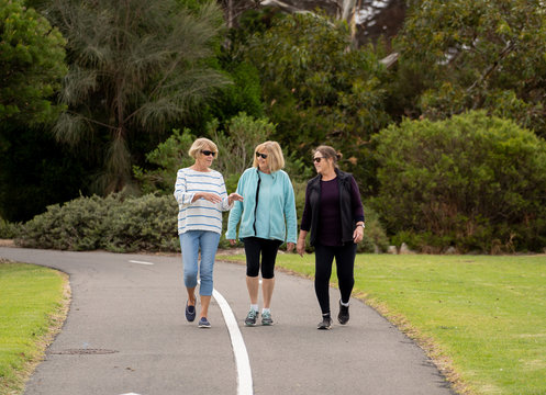 Happy active senior citizen women walking and training together in healthy retirement lifestyle