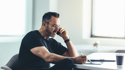 Businessman busy working in office
