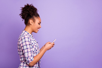 Profile side view photo positive cheerful people blogger blog use user device search news feed true smm communicate conversation checkered shirt free time weekend top-knot isolated purple background