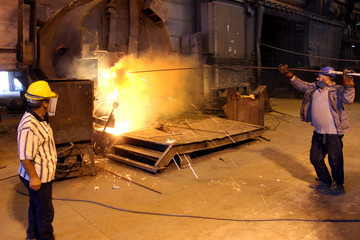 Libyan workers prepare a furnace at the Libyan Iron and Steel Company (Lisco), in Misrata