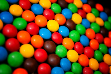 Colorful chewy dragees for background