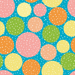 Vibrant orange, yellow and pink circles with random dots. Seamless vector pattern on sky blue background. Great for wellness, beauty, food products, packaging, kids, stationery giftwrap