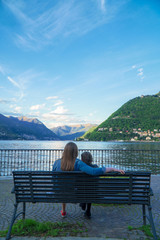 Woman and her daughter resting near the lake Como.
